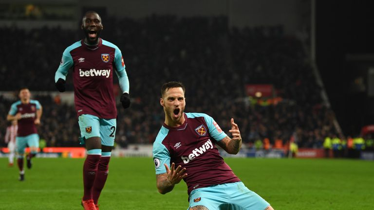 Marko Arnautovic celebrates after scoring his side's second goal