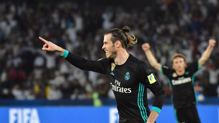 Real Madrid's Welsh forward Gareth Bale (C) celebrates after scoring during the FIFA Club World Cup semi-final match in the Emirati capital Abu Dhabi on De