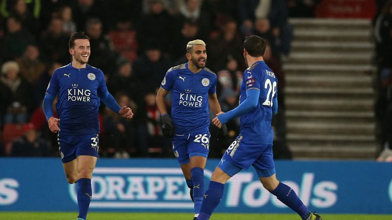 SOUTHAMPTON, ENGLAND - DECEMBER 13: Riyad Mahrez of Leicester City celebrates after scoring his sides first goal with Christian Fuchs of Leicester City and