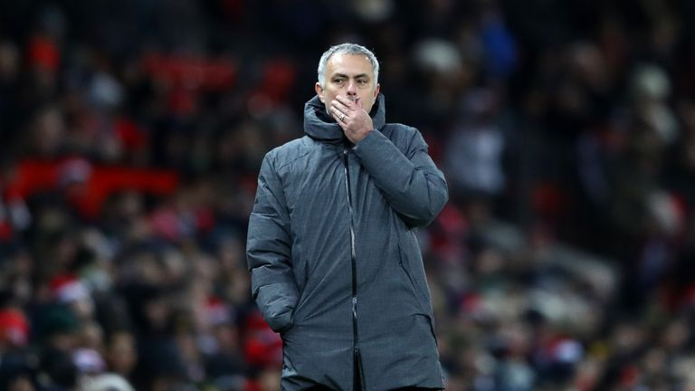 Jose Mourinho looks on with his side 2-1 down in the Manchester derby