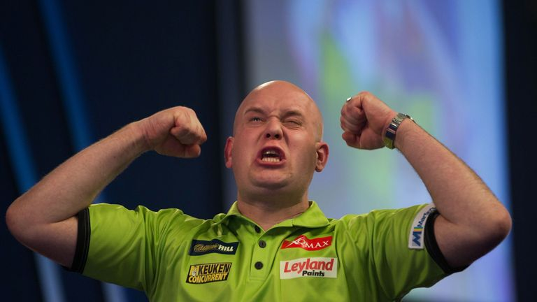 Michael van Gerwen celebrates after his victory in the PDC World Championship darts final over Scotland's Gary Anderson at Alexandra Palace