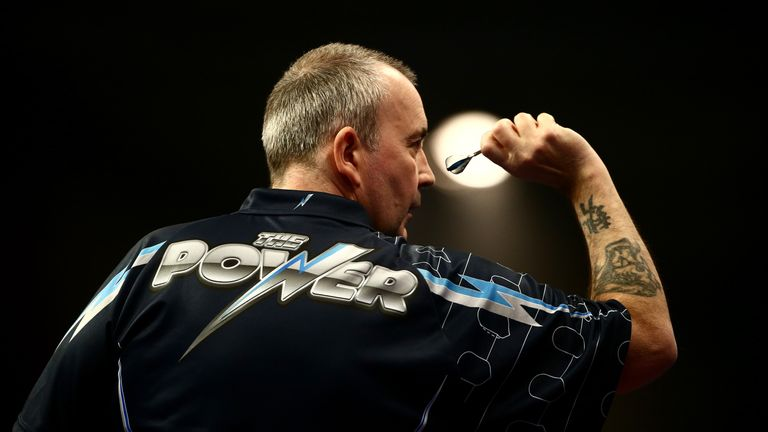 LONDON, ENGLAND - DECEMBER 19:  Phil Taylor of England in action during his first round match against Jyhan Artut of Germany on Day Two of the William Hill