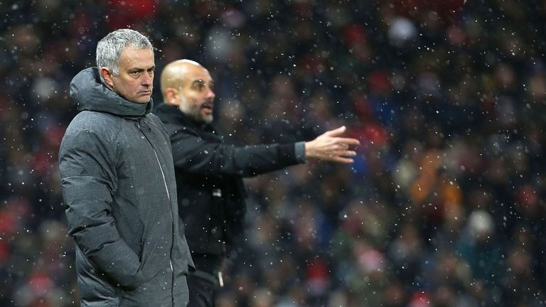 Jose Mourinho and Pep Guardiola watch from the Old Trafford touchline