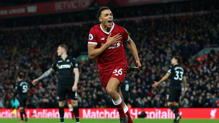 Trent Alexander-Arnold celebrates after making it 3-0 at Anfield