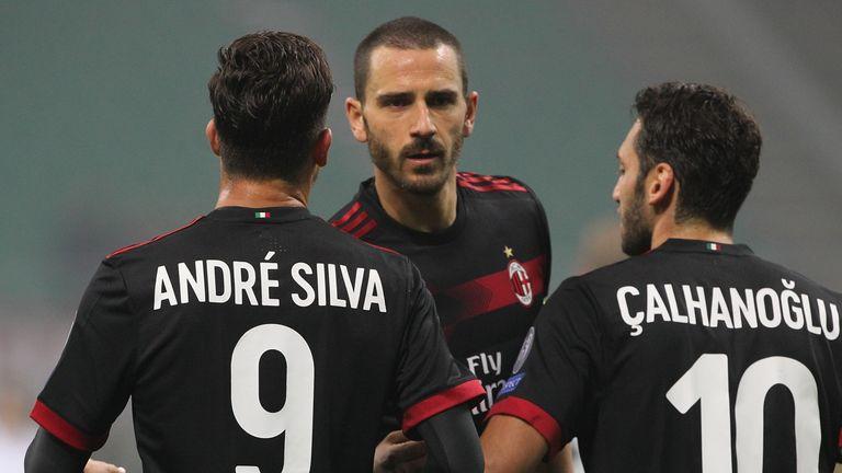 MILAN, ITALY - NOVEMBER 23:  Andre Silva (L) of AC Milan celebrates his goal with his team-mates Leonardo Bonucci (C) and Hakan Calhanoglu (R) during the U