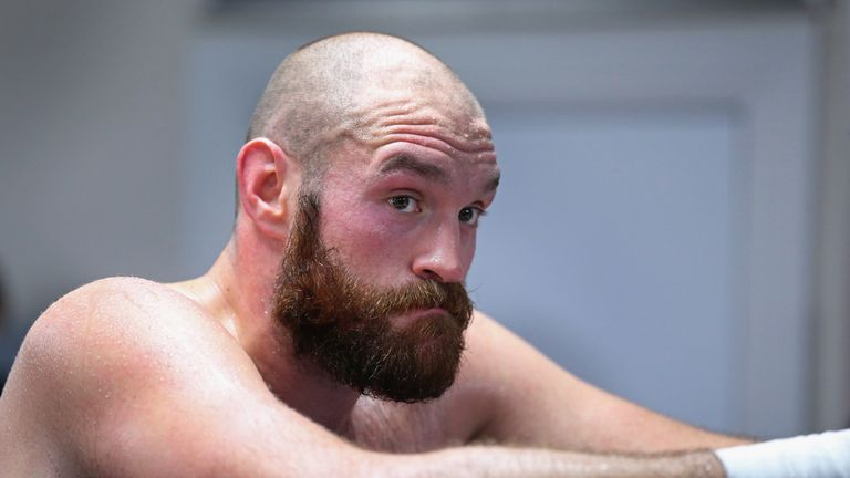 BOLTON, ENGLAND - NOVEMBER 06:  Tyson Fury looks on during a training session at Team Fury Gym ahead of his fight with Dereck Chisora on November 6, 2014 i