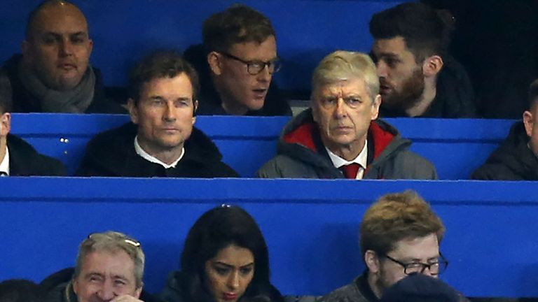 Arsenal manager Arsene Wenger sits beside Jens Lehmann in the press box