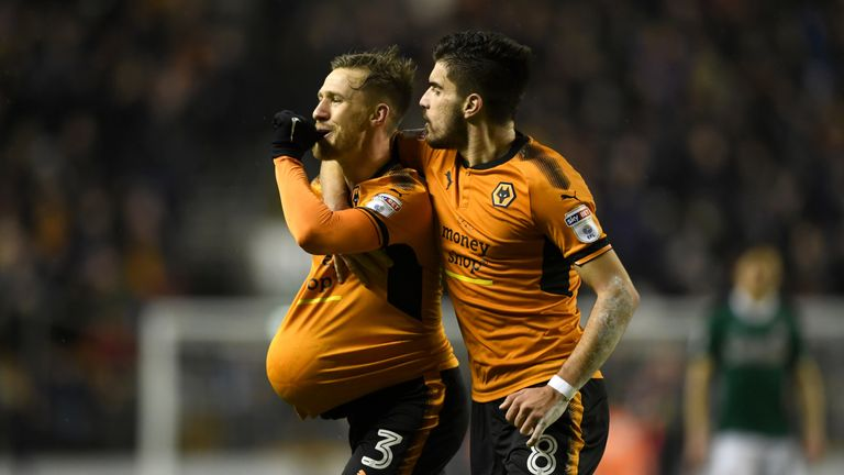 Barry Douglas celebrates with Ruben Neves after scoring Wolves's second goal