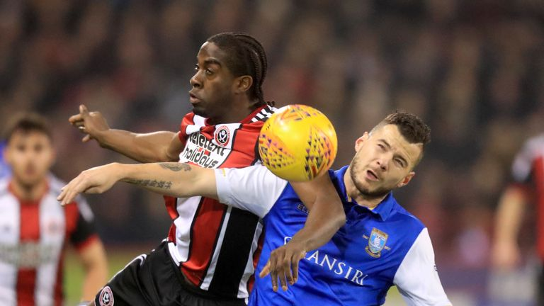 Daniel Pudil (right) and Clayton Donaldson battle for the ball