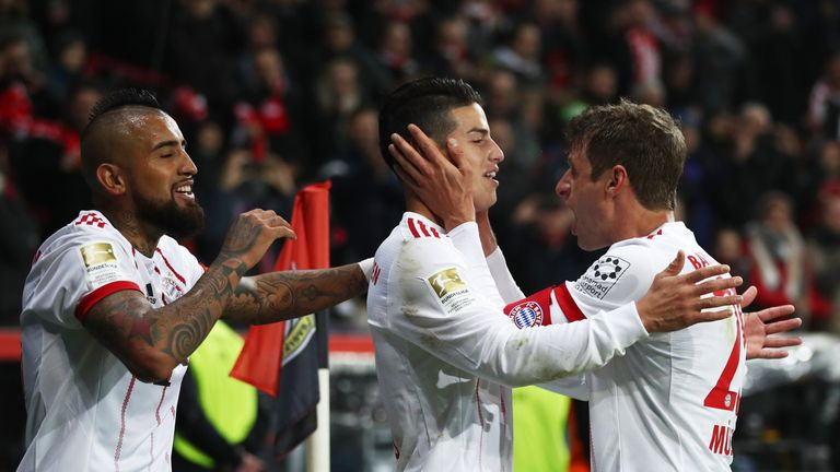 James Rodriguez celebrates after scoring for Bayern Munich against Bayer Leverkusen