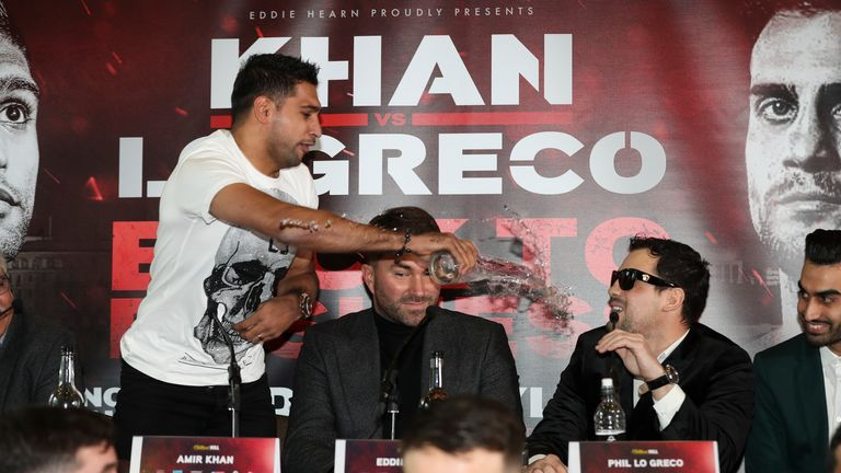 Khan throws a glass of water over Phil Lo Greco at their press conference earlier this year