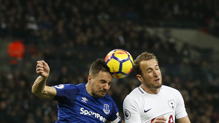 Phil Jagielka challenges Harry Kane during the game at Wembley
