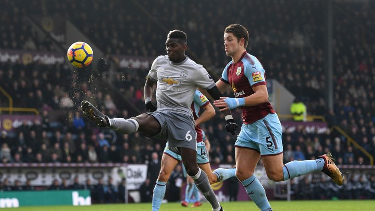 Paul Pogba controls the ball while under pressure from James Tarkowski