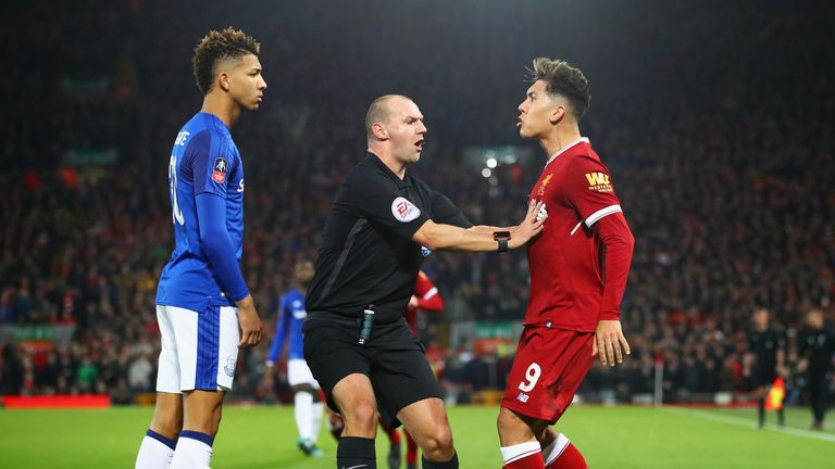 Referee Robert Madley intervenes as Mason Holgate and Roberto Firmino clash