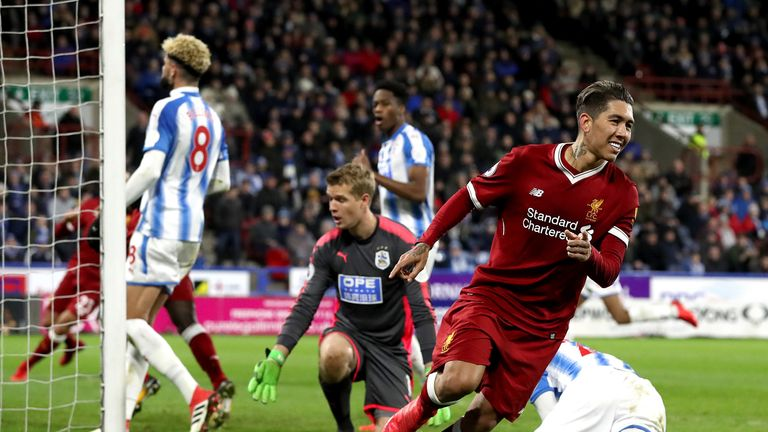 Roberto Firmino celebrates as he doubles Liverpool's lead