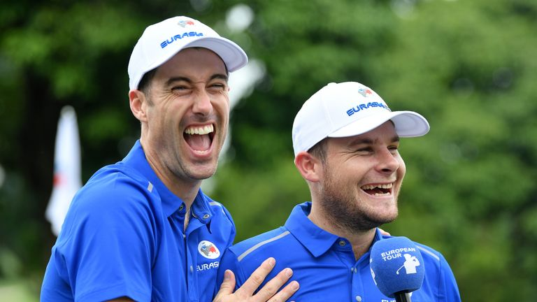 Ross Fisher and Tyrrell Hatton share a joke after their crushing win