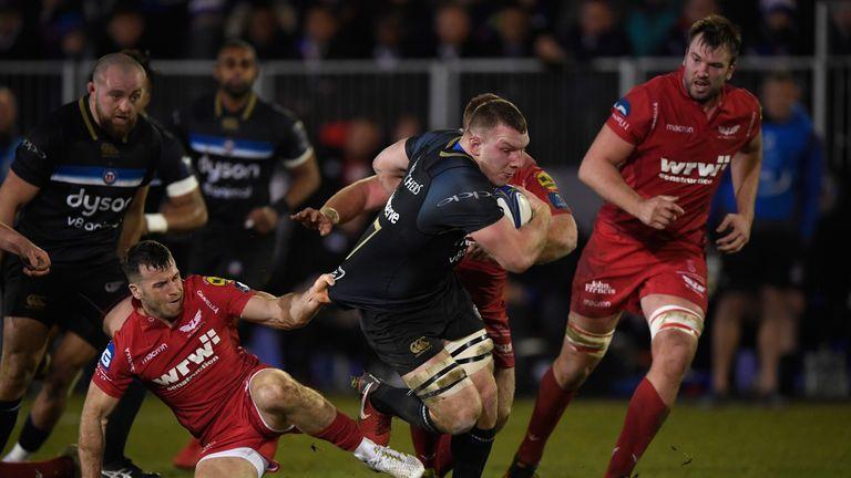 Sam Underhill  tries to get away from Gareth Davies
