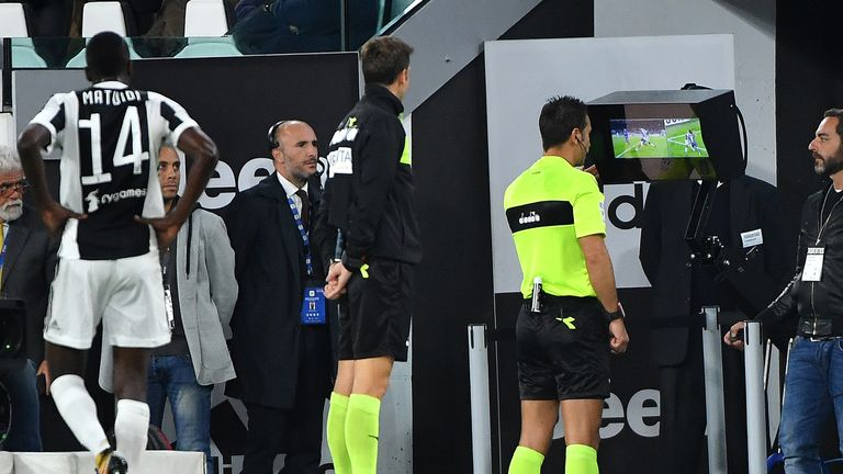 Referee Daniele Doveri (C) undergoes an On-Field Review during Juventus' Serie A match with Fiorentina back in September