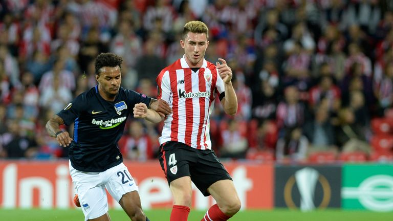 Hertha BSC Berlin's Austrian midfielder Valentino Lazaro (L) vies with Athletic Bilbao's French defender Aymeric Laporte during the Europa League football