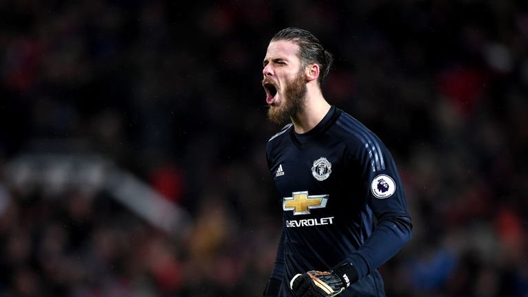 David De Gea celebrates his side's second goal against Stoke City at Old Trafford