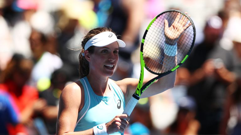 Johanna Konta of Great Britain celebrates after winning her first round match against Madison Brengle of the United States