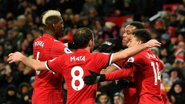 Manchester United's French striker Anthony Martial (2R) celebrates scoring their second goal with Manchester United's French midfielder Paul Pogba (L), Man