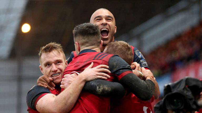 Munster's Keith Earls celebrates his try with Rory Scannell, Conor Murray and Simon Zebo