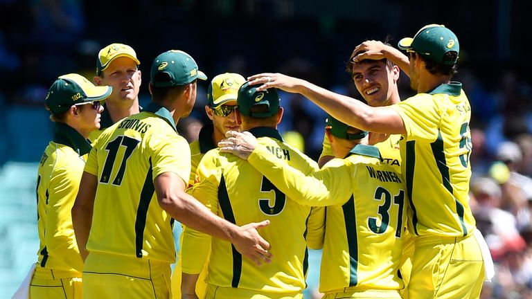 SYDNEY, AUSTRALIA - JANUARY 21:  Pat Cummins of Australia is congratulated by team mates after taking the wicket of Jason Roy of England during game three