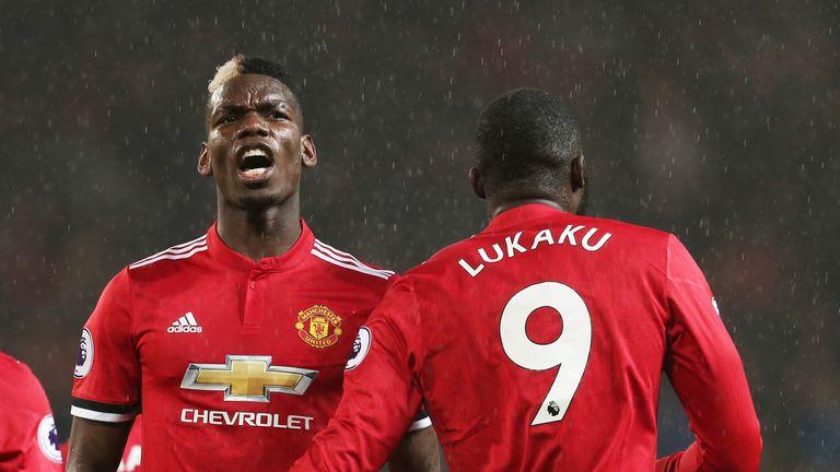 Paul Pogba celebrates after Romelu Lukaku makes it 3-0 against Stoke City at Old Trafford