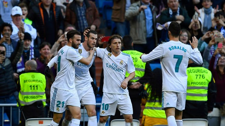 Real Madrid team-mates celebrate with Gareth Bale after his first goal