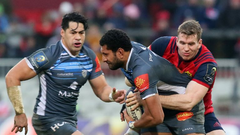 Munster's Chris Farrell (R) tackles Castres' Tongan flanker Steve Mafi during the European Champions Cup Pool 4 rugby union match