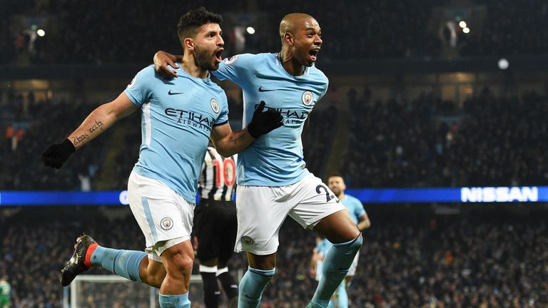 Sergio Aguero celebrates completing his hat-trick with Fernandinho