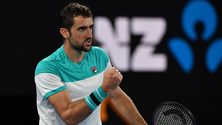 Croatia's Marin Cilic reacts against Switzerland's Roger Federer during their men's singles final match on day 14 of the Australian Open