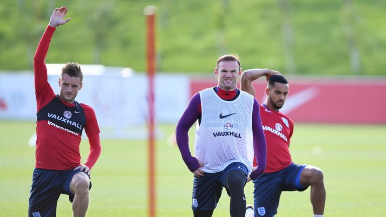 Jamie Vardy, Wayne Rooney and Theo Walcott of England stretch during an England training session at St George's Park in October, 2016