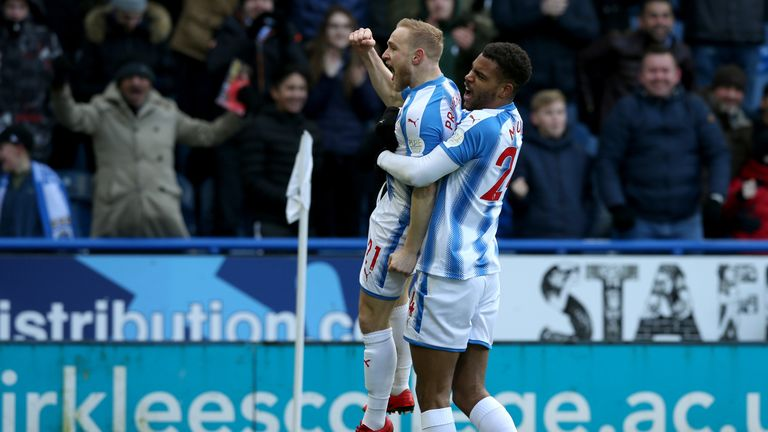Alex Pritchard is congratulated by Steve Mounie (right) after opening the scoring