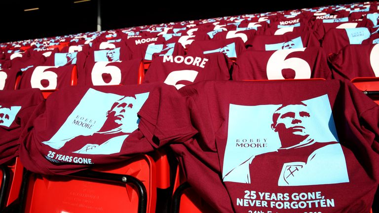 Shirts in memory of Bobby Moore are displayed ahead of the Premier League match between Liverpool and West Ham United at London Stadium