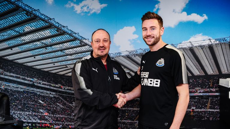 Paul Dummett poses with Newcastle United manager Rafael Benitez after committing to the club