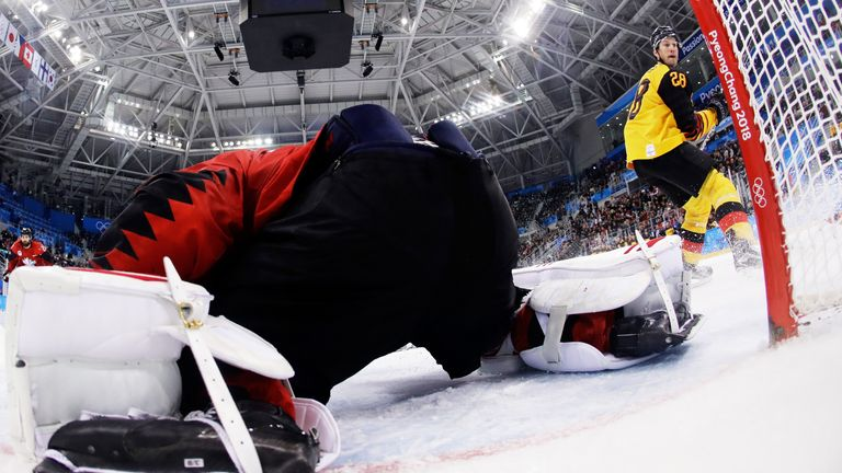 Mauer watches as his audacious shot beats Canada goalie Kevin Poulin