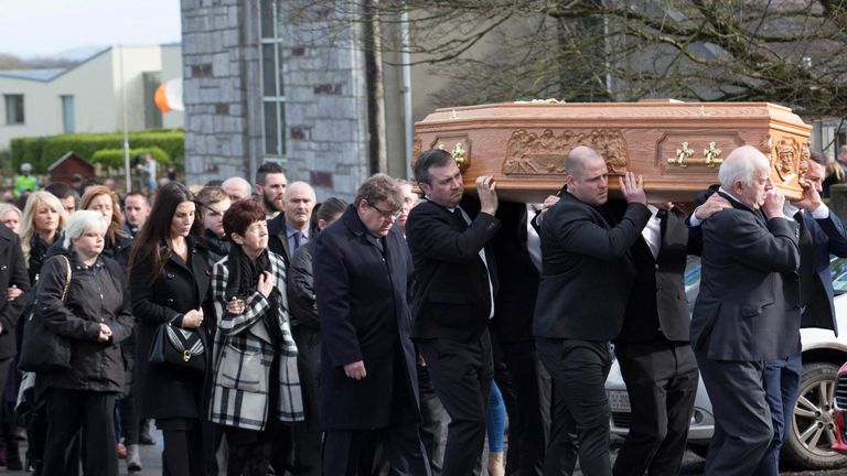 Mourners attend the funeral of former Celtic and Manchester United footballer Liam Miller
