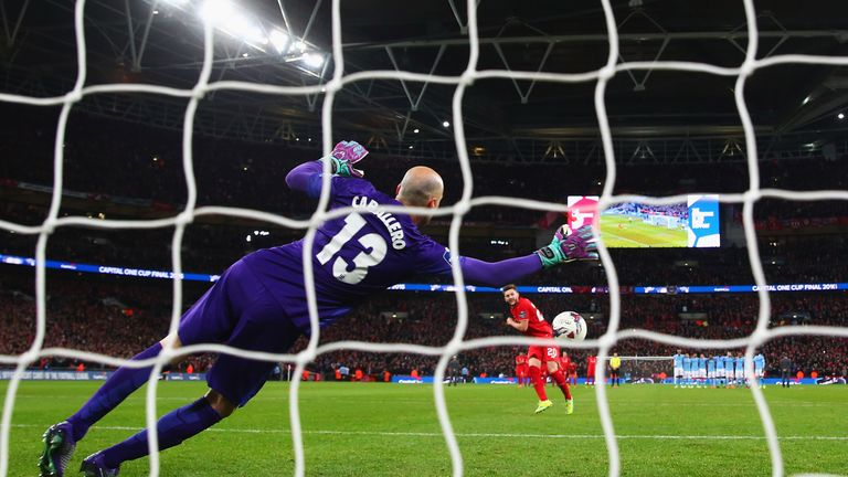 Willy Caballero of Manchester City saves a penalty from Adam Lallana of Liverpool