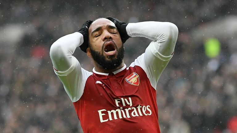 Alexandre Lacazette reacts following a missed chance against Spurs