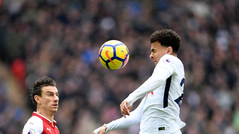 Spurs midfielder Dele Alli battles for the ball in the first half