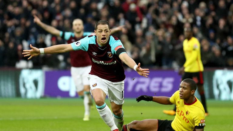 Javier Hernandez celebrates after scoring the opening goal of the game