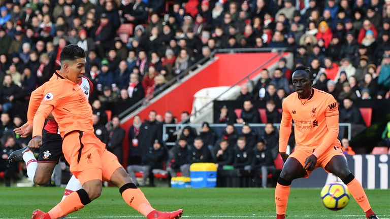 Roberto Firmino of Liverpool scores his sides first goal during the Premier League match between Southampton and Liver