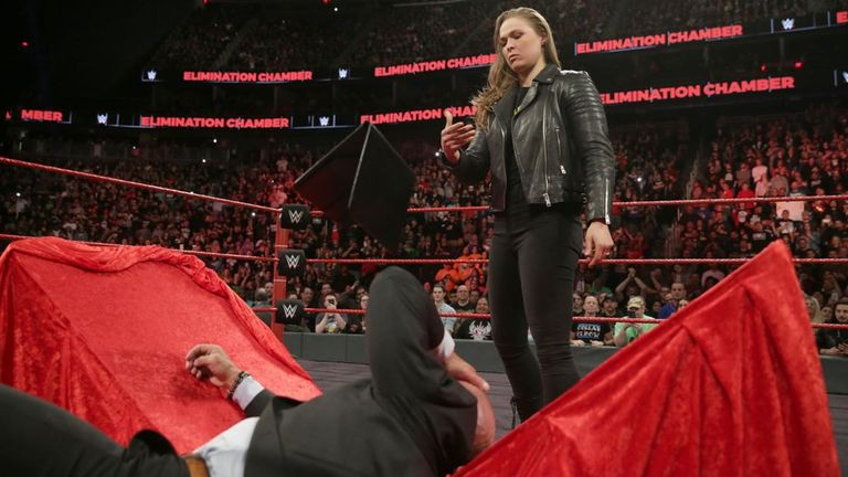 Ronda Rousey slams Triple H through at table at WWE's Elimination Chamber