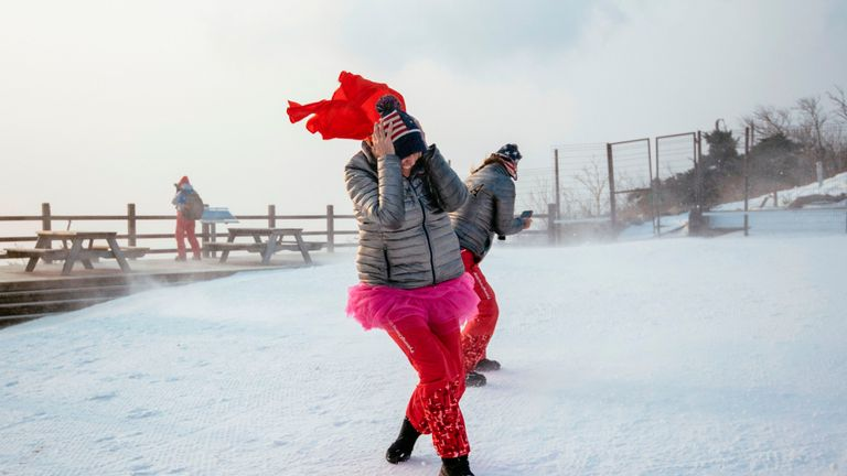 US fans brave the wind as the start of the Alpine Skiing Women's Slalom was delayed due to weather conditions