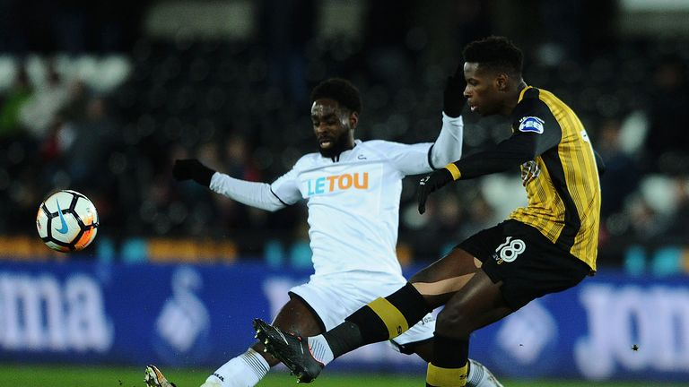 Nathan Dyer tackles Lucas Joao during the game at the Liberty Stadium