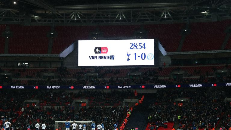 A decision is reviewed by VAR during FA Cup fifth-round replay between Tottenham and Rochdale