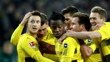 Marco Reus (left) celebrates his first goal since May with his Dortmund team-mates
