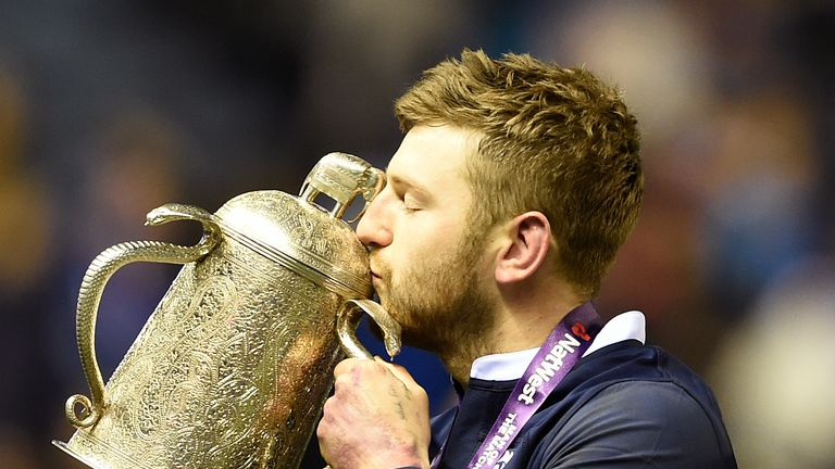 Finn Russell celebrates with the Calcutta Cup